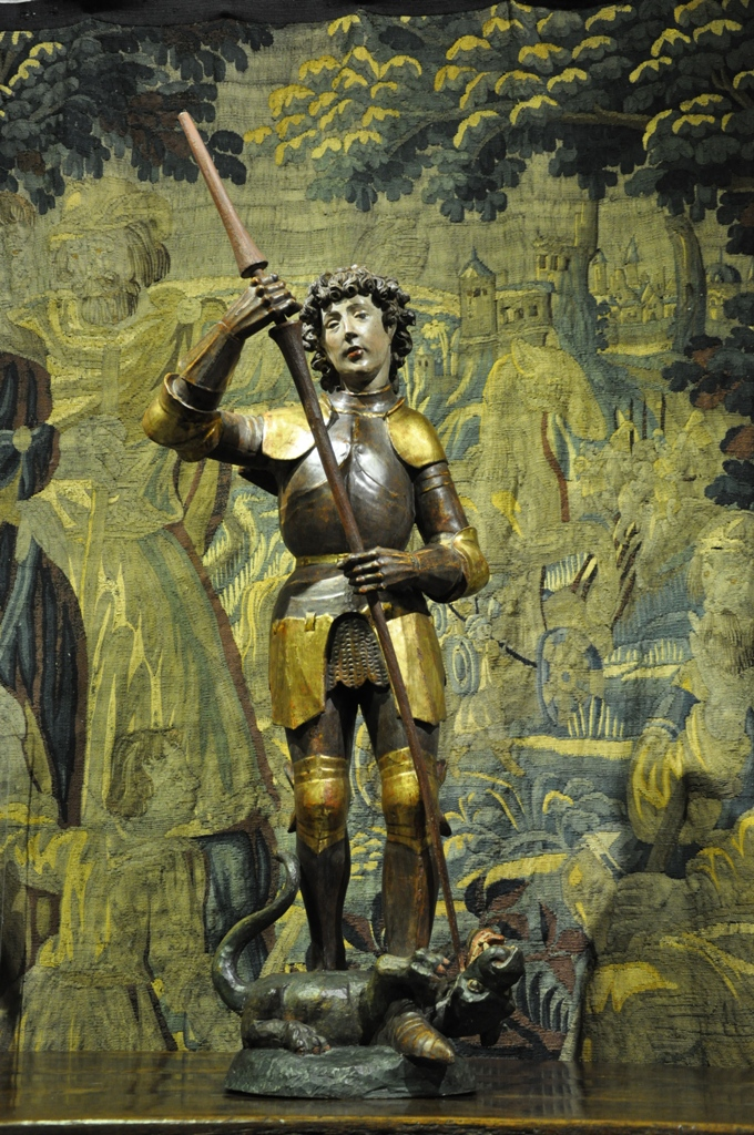 A 15TH CENTURY POLYCHROMED SCULPTURE OF ST GEORGE AND THE DRAGON. SOUTH GERMAN. CIRCA 1480.