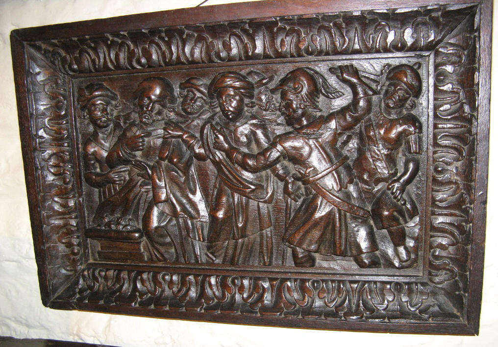 A 16TH CENTURY CARVED OAK PANEL SHOWING THE DENIAL OF ST PETER. CIRCA 1550.
