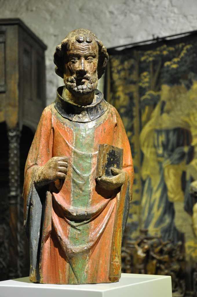 A BEAUTIFUL EARLY 14TH CENTURY CARVED AND POLYCHROMED SCULPTURE OF AN APOSTLE. SAXONY. CIRCA 1320.