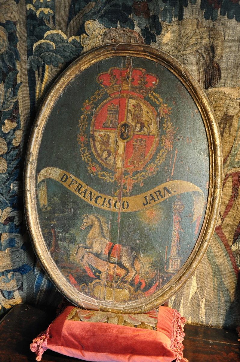 A BEAUTIFUL EARLY 18TH CENTURY  OVAL PANEL OF THE SPANISH ROYAL COAT OF ARMS. CIRCA 1720.