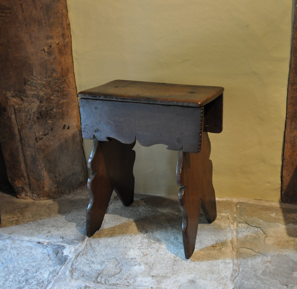 A EARLY 16TH CENTURY OAK BOARDED STOOL. ENGLISH. CIRCA 1620.