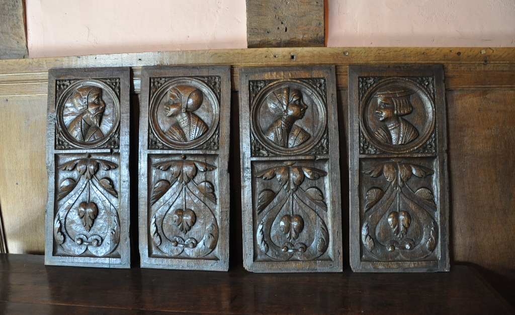 A FINE AND RARE SET OF FOUR ENGLISH EARLY 16TH CENTURY CARVED OAK PORTRAIT PANELS. CIRCA 1530.