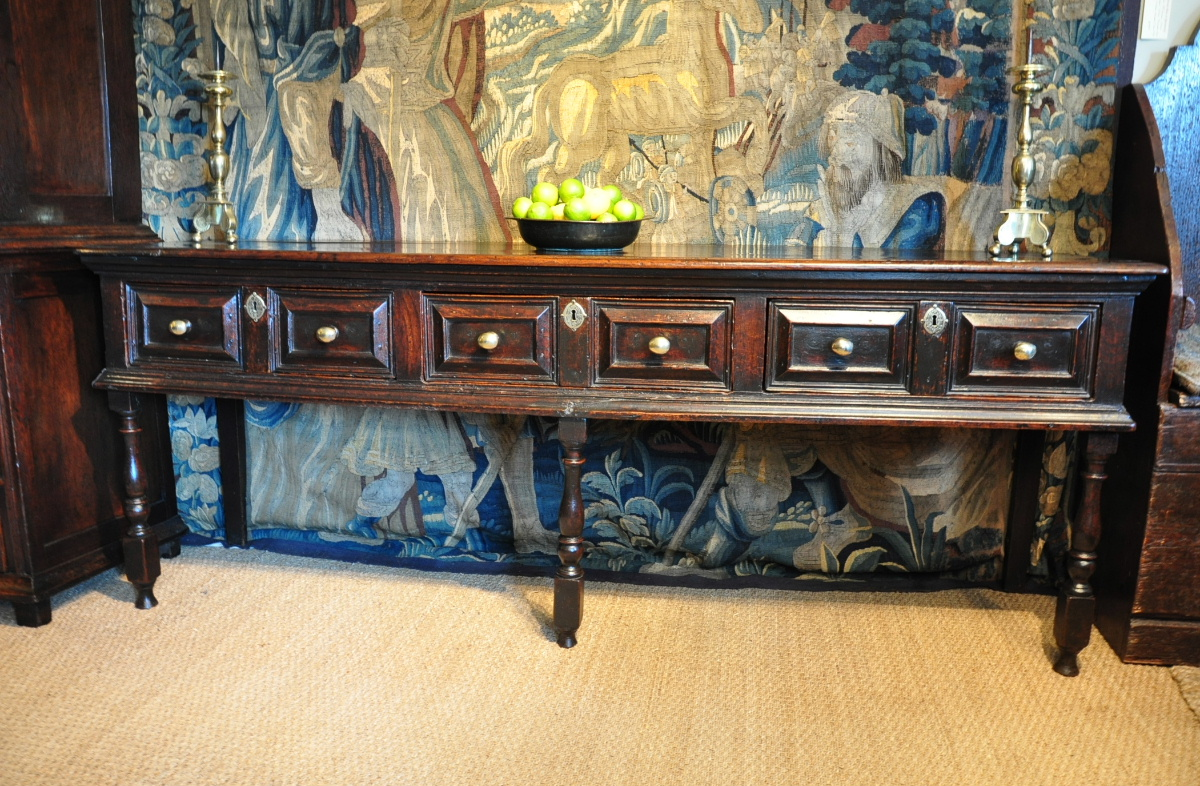 A FINE LARGE CHARLES II OAK CUSHION FRONTED SERVING DRESSER. CIRCA 1680.