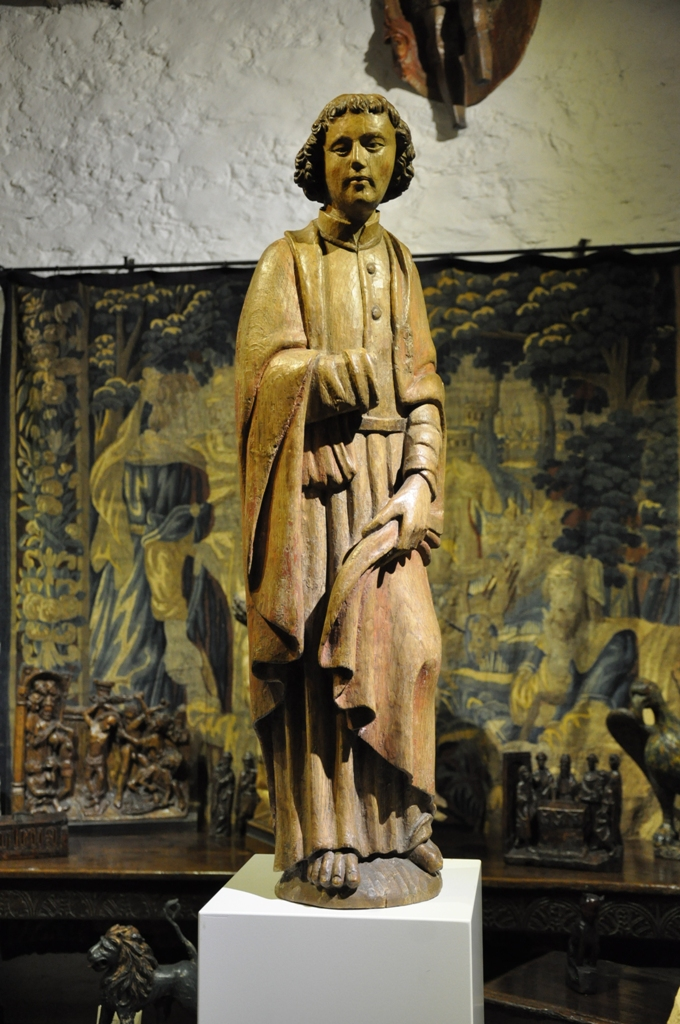 A FINE LATE MEDEIVAL OAK SCULPTURE OF ST JOHN. NETHERLANDS. CIRCA 1470.