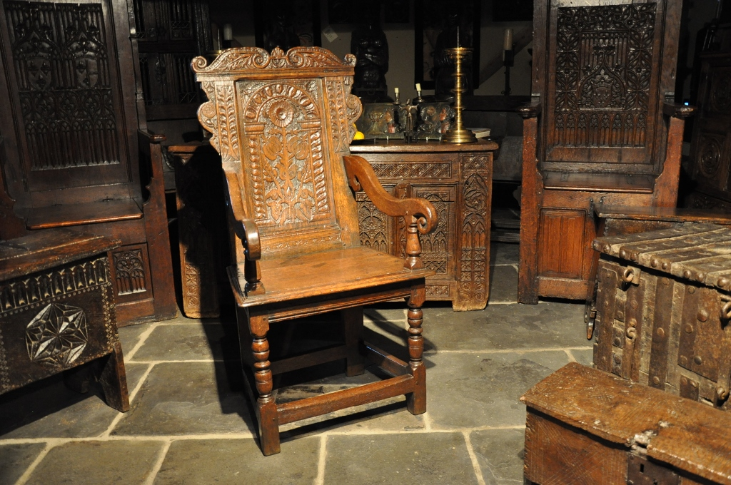 A HANDSOME MID 17TH CENTURY CARVED OAK WAINSCOT ARMCHAIR. ENGLISH. CIRCA 1650.