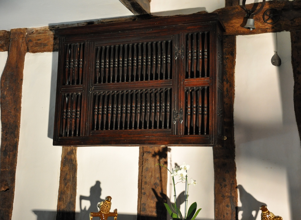 A LARGE AND RARE 17TH CENTURY ENGLISH PLUM WOOD MURAL / DOLE CUPBOARD. CIRCA 1690.