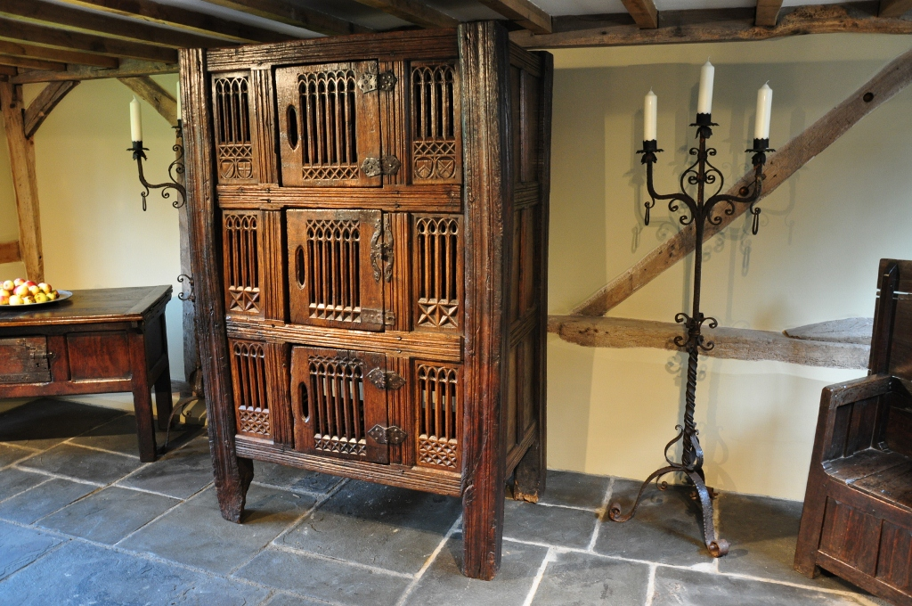 A MAGNIFICENT AND IMPRESSIVE MID 15TH CENTURY ENGLISH OAK GREAT HALL CUPBOARD. CIRCA 1460.