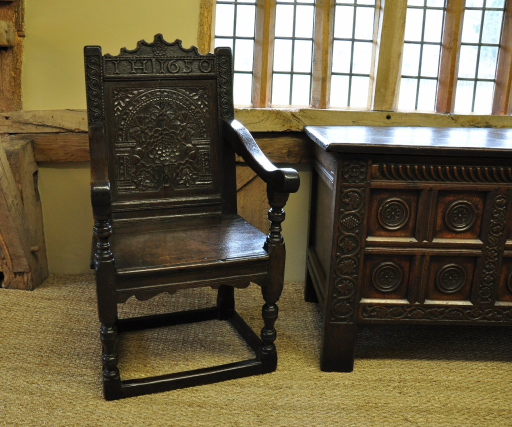 A MID 17TH CENTURY ENGLISH CARVED AND DATED OAK WAINSCOT CHAIR.