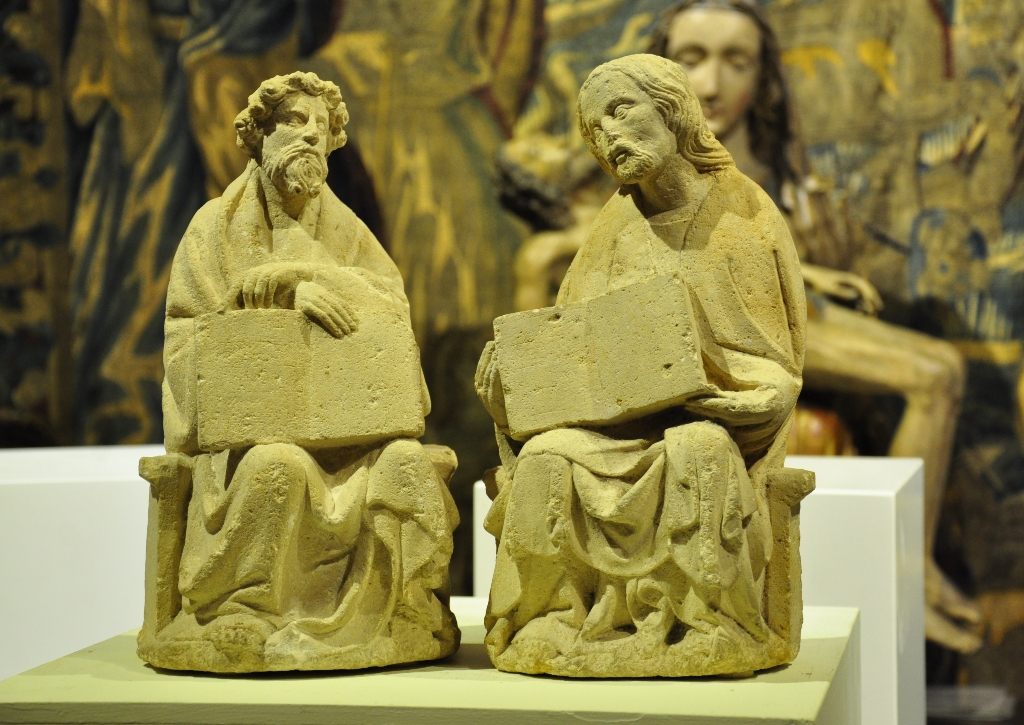 A PAIR OF LATE 14TH CENTURY CARVED LIMESTONE SEATED FIGURES OF TWO EVANGELISTS / SCHOLARS. MIDDLE RHINELAND. CIRCA 1380-1400.