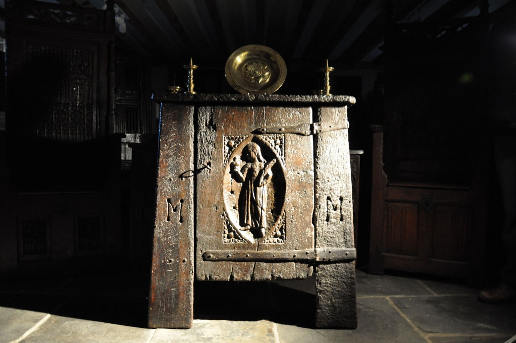 A RARE 15TH CENTURY NORMAN OAK AUMBRY OF UNUSUAL RAKED FORM. CIRCA 1470.