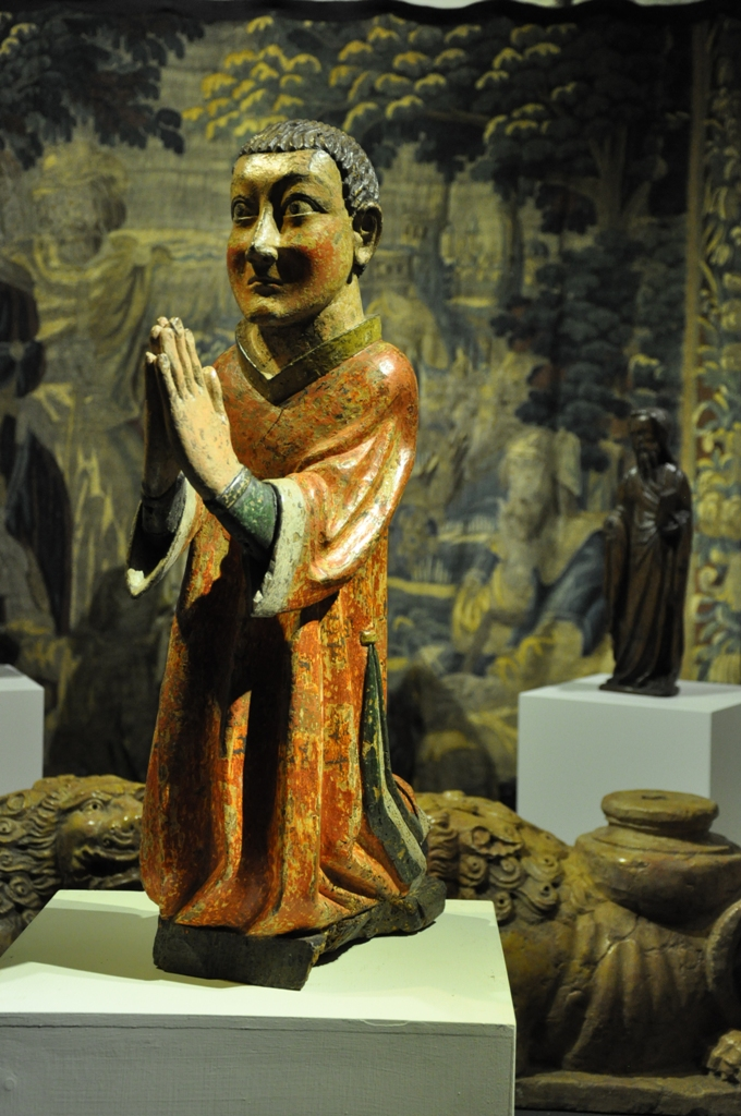 A RARE 15TH CENTURY NORMAN SCULPTURE OF A SAINT KNEELING IN PRAYER. CIRCA 1450.