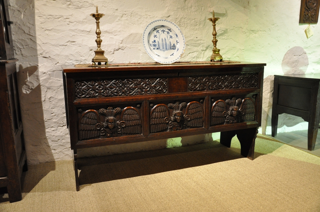 A RARE AND POSSIBLY UNIQUE CHARLES I CARVED OAK CHEST. SOUTHERN ENGLAND. CIRCA 1640.