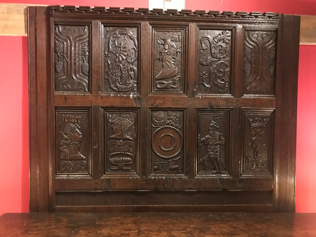 A RARE EARLY 16TH CENTURY ENGLISH CARVED OAK OVERMANTLE/ HEADBOARD . CIRCA 1520.