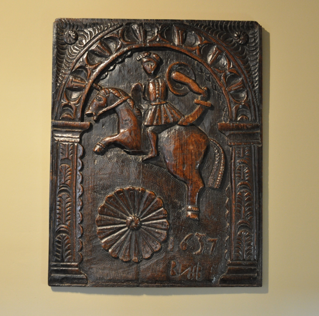 A RARE EARLY 17TH CENTURY ENGLISH CARVED OAK PANEL OF KING CHARLES I ON HORSEBACK. DATED 1637.
