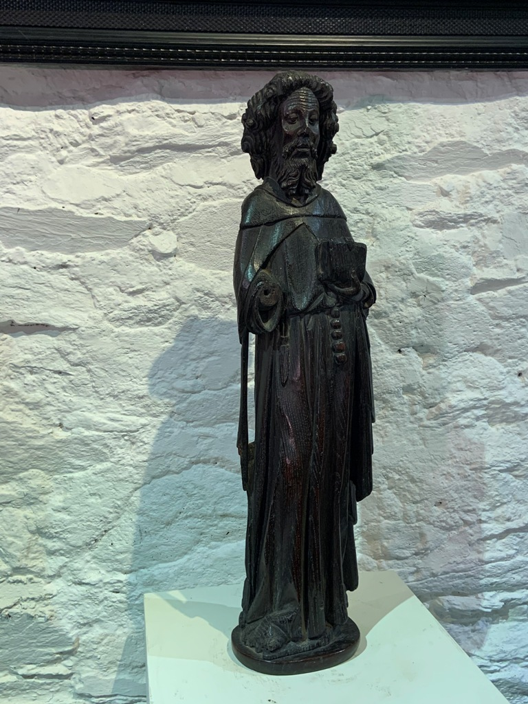 A RARE MID 14TH CENTURY ENGLISH OAK SCULPTURE OF ST MATHEW. HOME COUNTIES. CIRCA 1350.