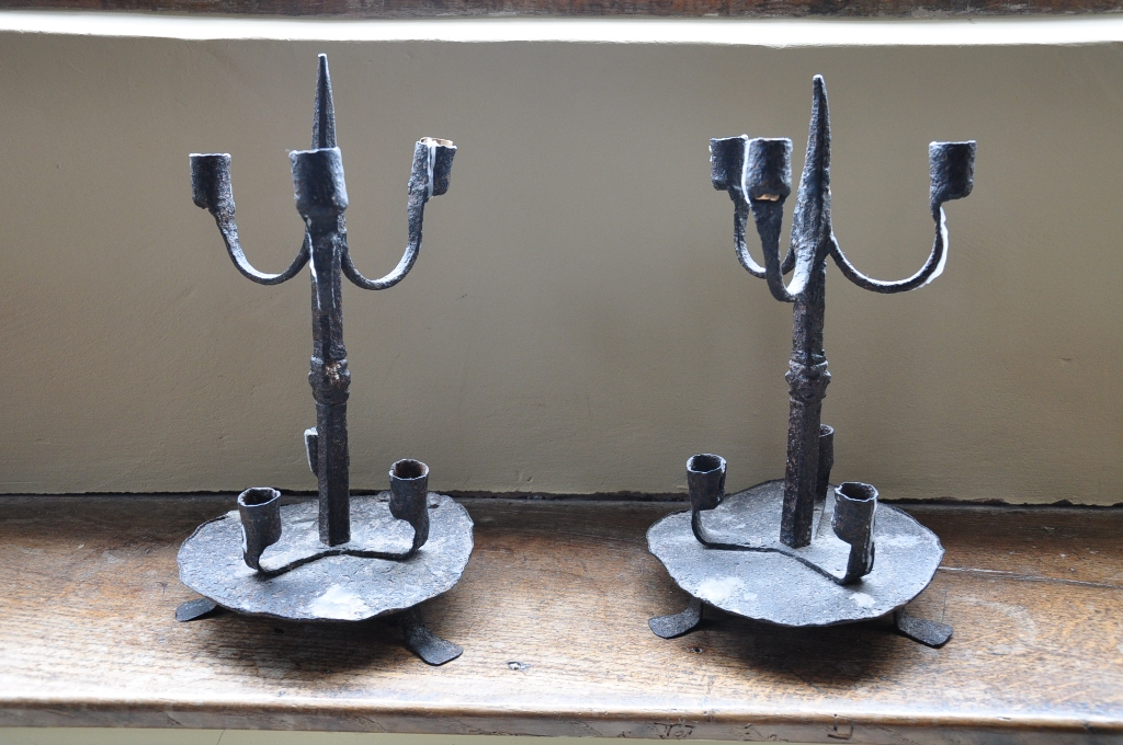 A RARE PAIR OF 16TH CENTURY IRON PRICKET CANDELABRA. CIRCA 1550.