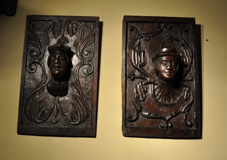 A RARE PAIR OF HENRY VIII CARVED OAK PANELS. ENGLISH. CIRCA 1530.