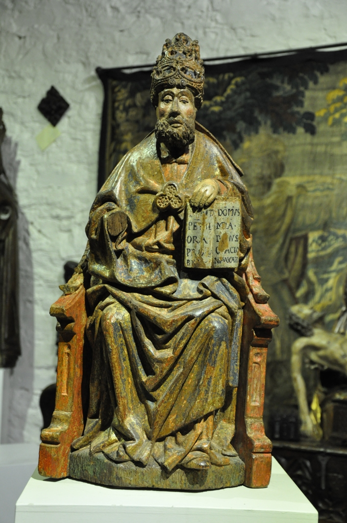 A STUNNING 15TH CENTURY OAK SCULPTURE OF ST PETER SEATED ON A GOTHIC THRONE. NORTHERN ITALY. CIRCA 1470.
