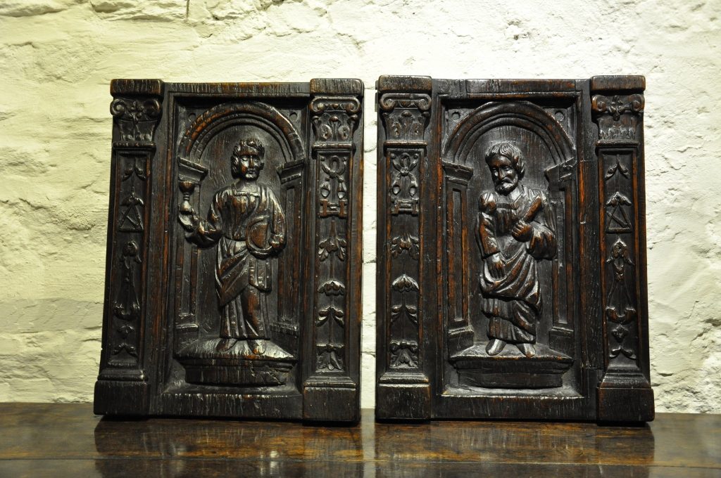 A SUBSTANTIAL PAIR OF 16TH CENTURY DEEPLY CARVED OAK PANELS. CIRCA 1580. FLEMISH.