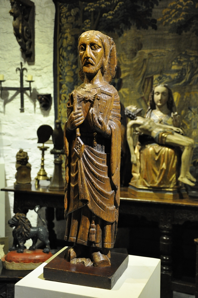 A TRULY IMPORTANT AND ASTONISHINGLY RARE ENGLISH OAK ROMANESQUE SCULPTURE OF ST PETER. SOUTHERN ENGLAND. CIRCA 1150.
