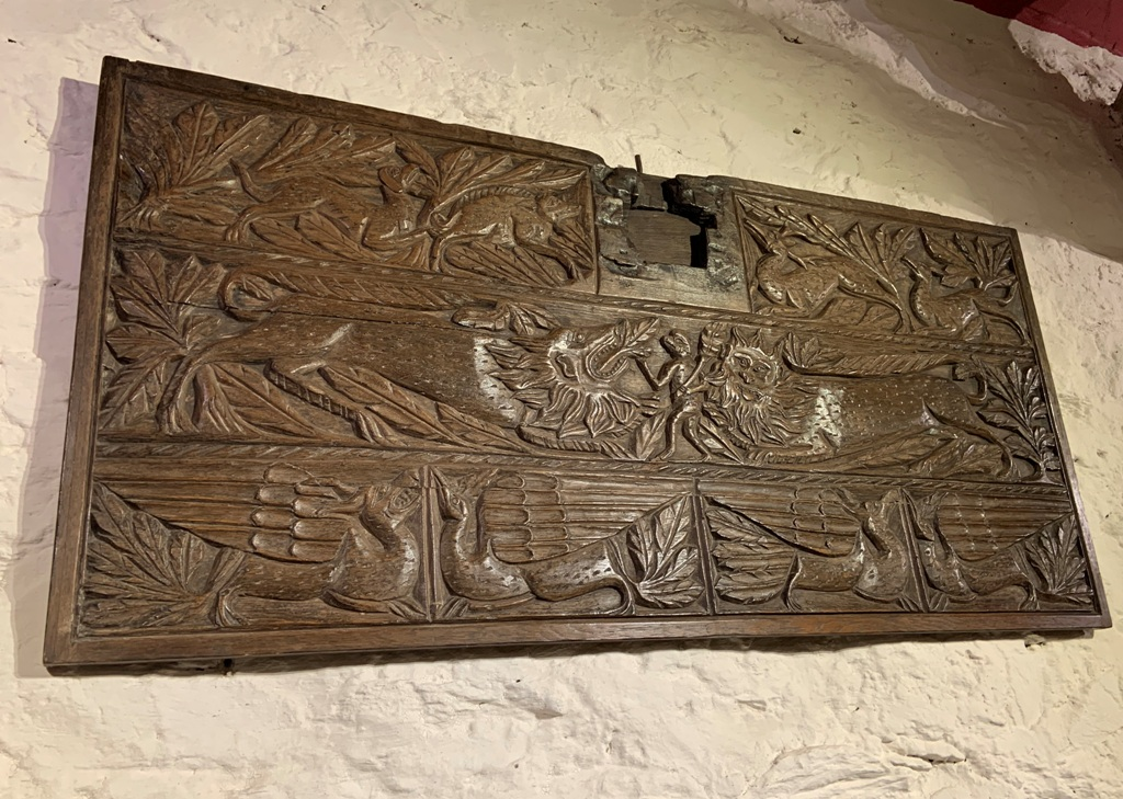 A TRULY RARE ENGLISH CARVED OAK PANEL. KENT /EAST ANGLIA. CIRCA 1350.