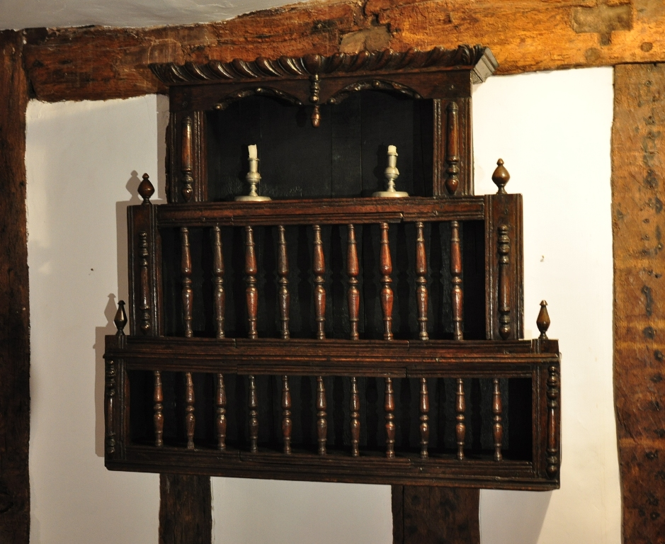 A VERY RARE AND UNUSUAL 17TH CENTURY OAK THREE TIER SPINDLE/DOLE CUPBOARD. ENGLISH. CIRCA 1650.