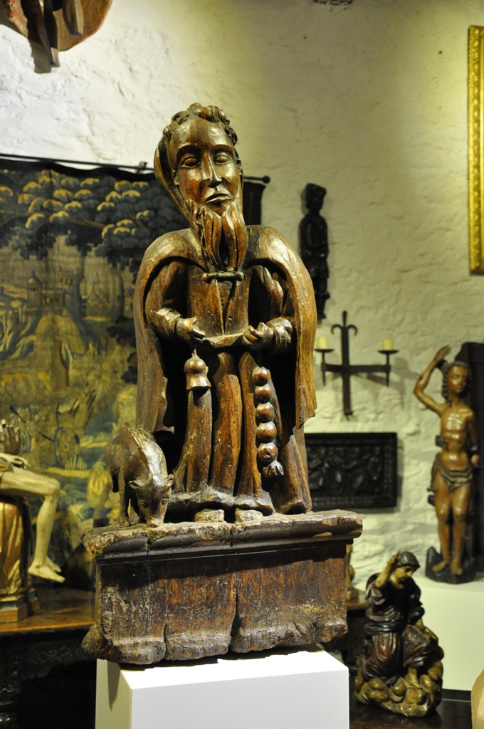 A WONDERFUL LATE 15TH CENTURY NORMAN WALNUT SCULPTURE OF ST ANTHONY. CIRCA 1500.