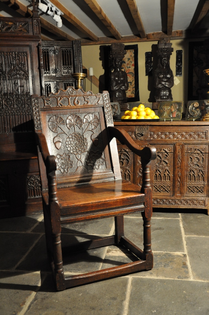 AN EXQUISITELY CARVED MID 17TH CENTURY ENGLISH  DATED 1657 OAK WAINSCOT ARMCHAIR.