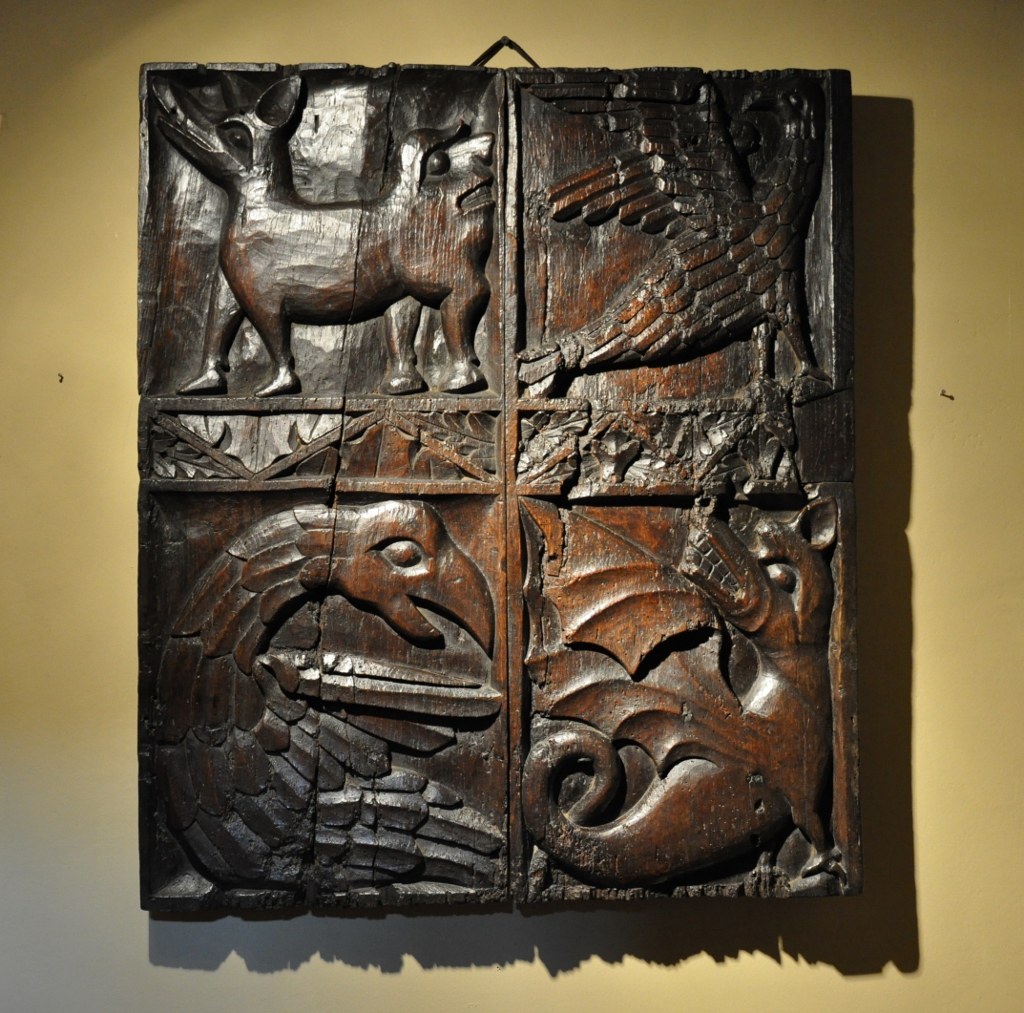 AN EXTREMELY RARE 15TH CENTURY ENGLISH OAK CARVING OF FOUR BESTIARY SYMBOLS. CIRCA 1450.