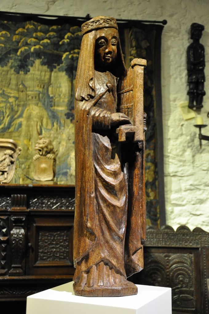 AN EXTREMELY RARE LATE MEDIEVAL NORMAN OAK SCULPTURE OF ST CECILIA. CIRCA 1500.