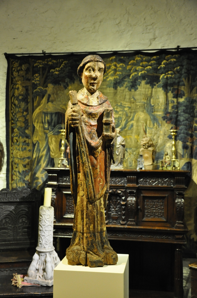 AN EXTREMELY RARE MID 13TH CENTURY ENGLISH OAK AND POLYCHROMED SCULPTURE OF ST BENEDICT. CIRCA 1250.
