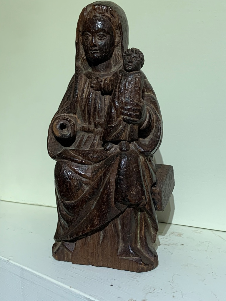 AN EXTREMELY RARE MID 13TH CENTURY ENGLISH OAK SCULPTURE OF THE VIRGIN AND CHILD. CIRCA 1250.