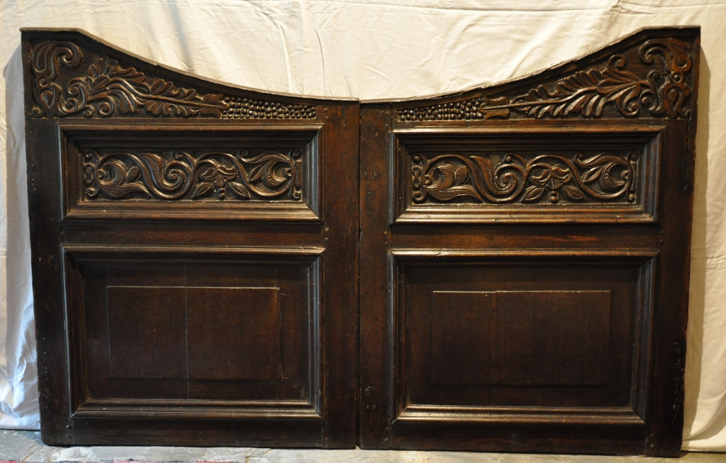 AN EXTREMELY RARE PAIR OF LATE 17TH CENTURY CARVED AND PIERCED OAK STAIR GATES. CIRCA 1680-1700.