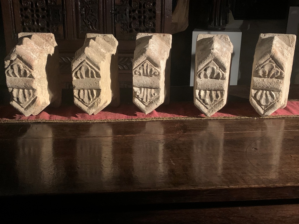 AN EXTREMELY RARE SET OF FIVE VOUSSOIR/CLOISTER STONES. HYDE ABBEY WINCHESTER. CIRCA 1130.
