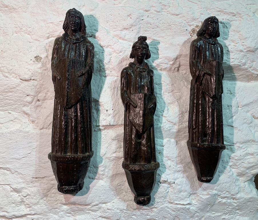 AN EXTREMELY RARE TRIO OF 15TH CENTURY ENGLISH OAK ROOF ANGELS. CIRCA 1470.