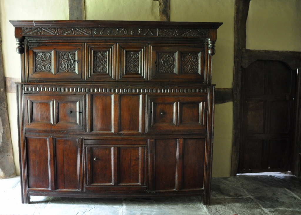 THE JOHN AND ANN BENSON WESTMORLAND OAK MARRIAGE CUPBOARD. DATED 1685.