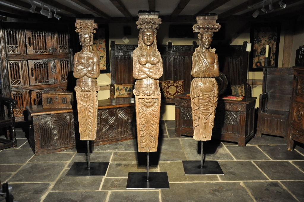 THREE MAGNIFICENT ALMOST LIFESIZE TUDOR PERIOD CARVED OAK FIGURES. ENGLAND. CIRCA 1570.