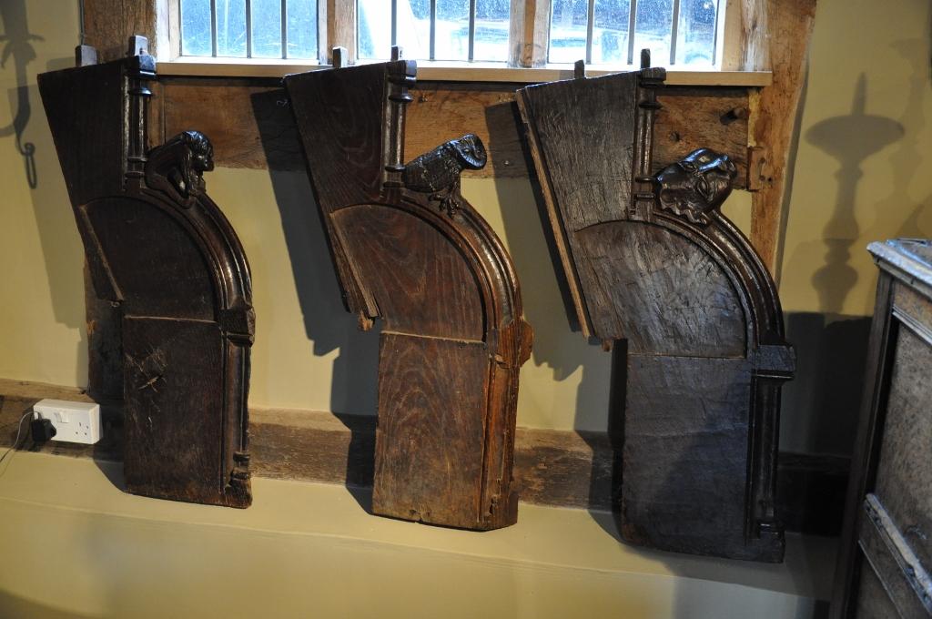 THREE RARE 15TH CENTURY GOTHIC OAK CHOIR STALL ENDS. CIRCA 1490.